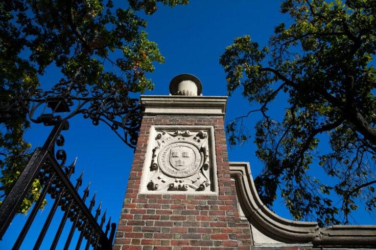Harvard gate against a blue sky.