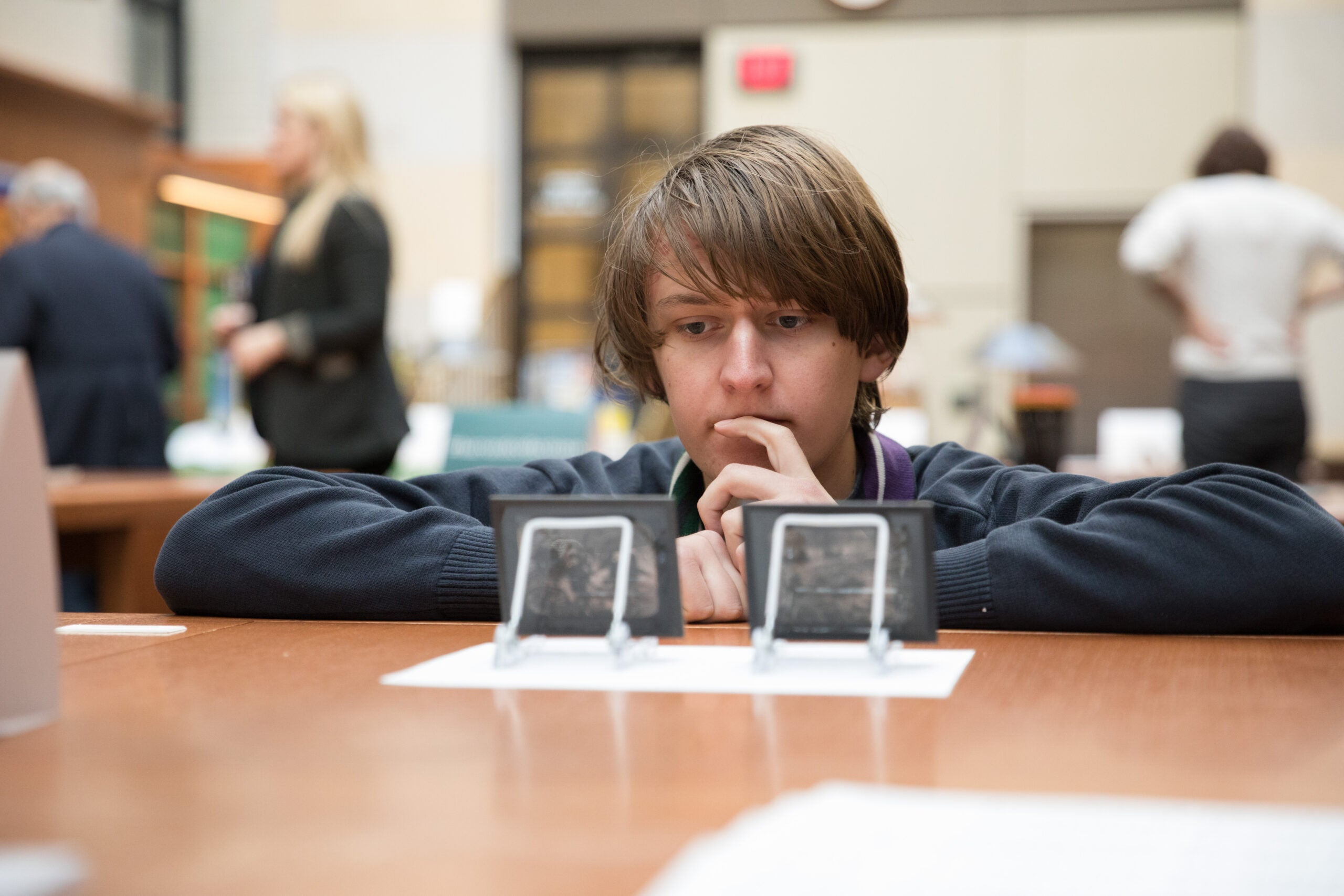 A student looks at glass slides.