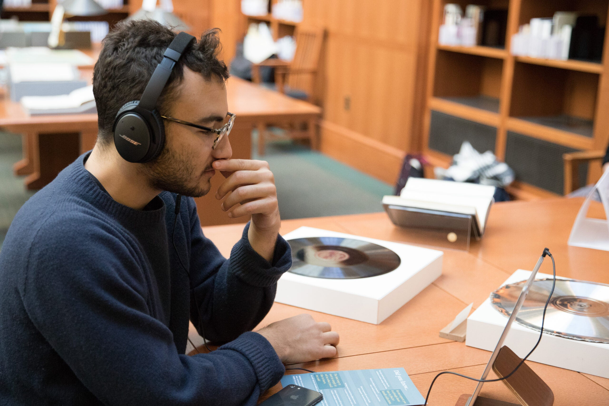 A student wearing headphones with records.