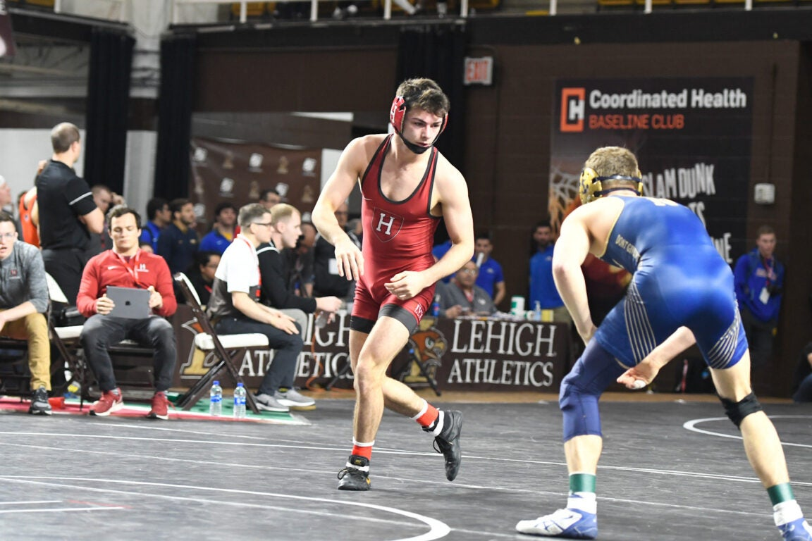 Two wrestlers circling one another.