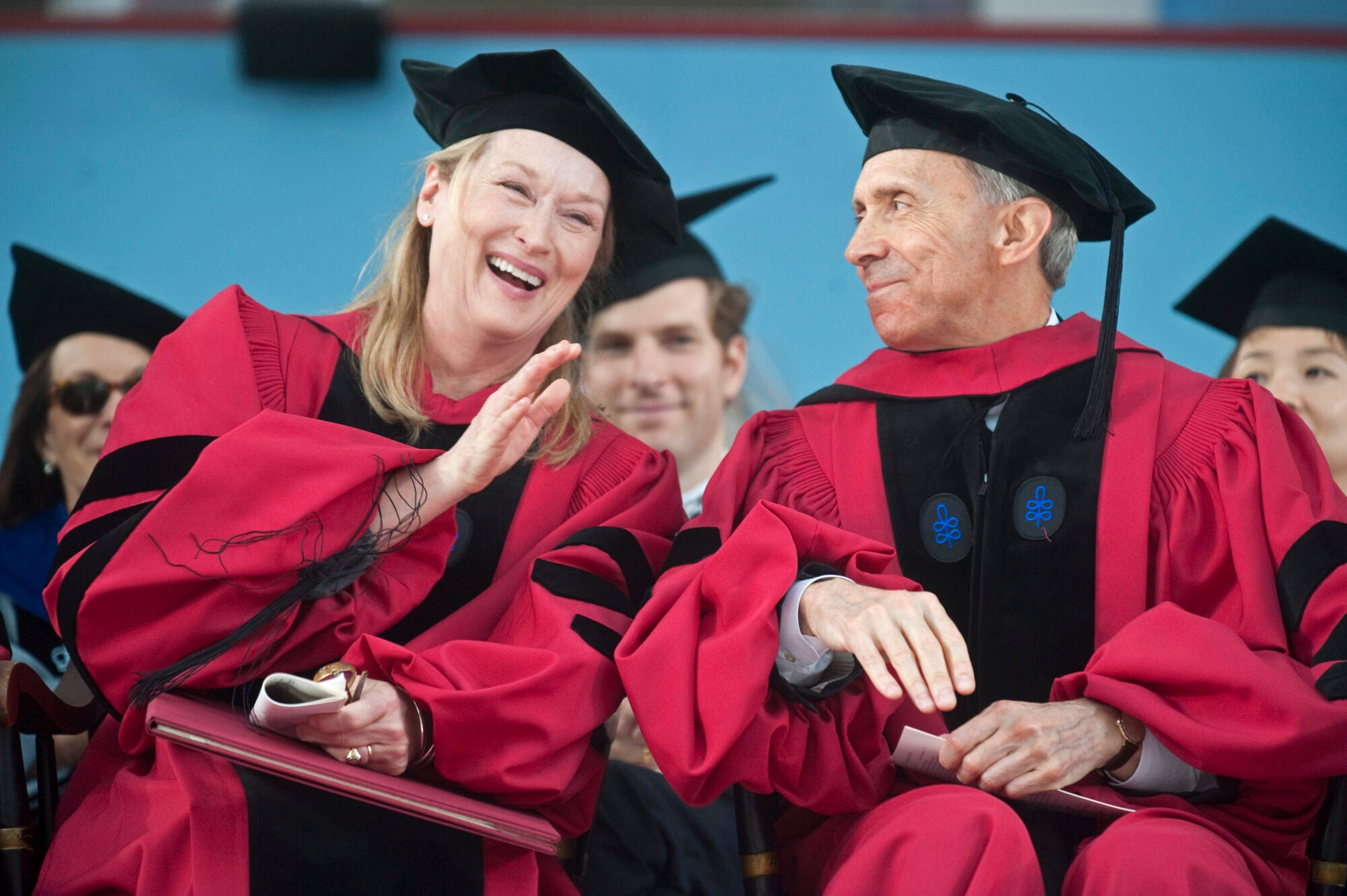 Meryl Streep laughing in her cap and gown