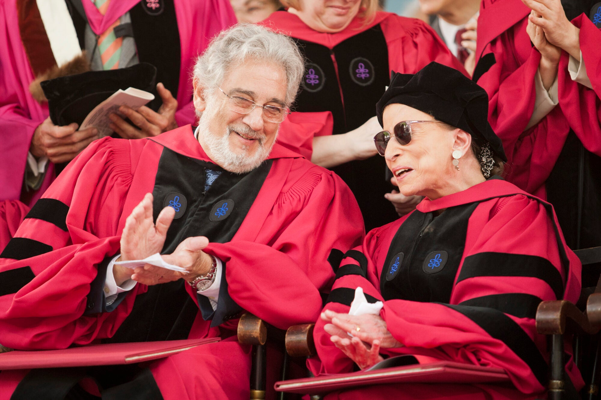 A man and a woman in cap and gown talk