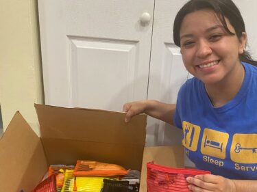A student with a box full of donations