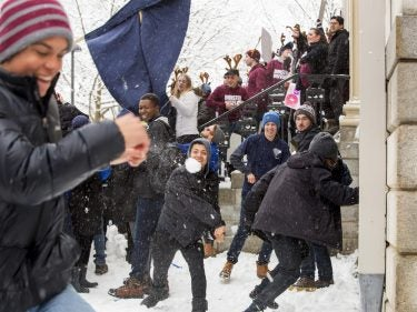 Student having a snowball fight