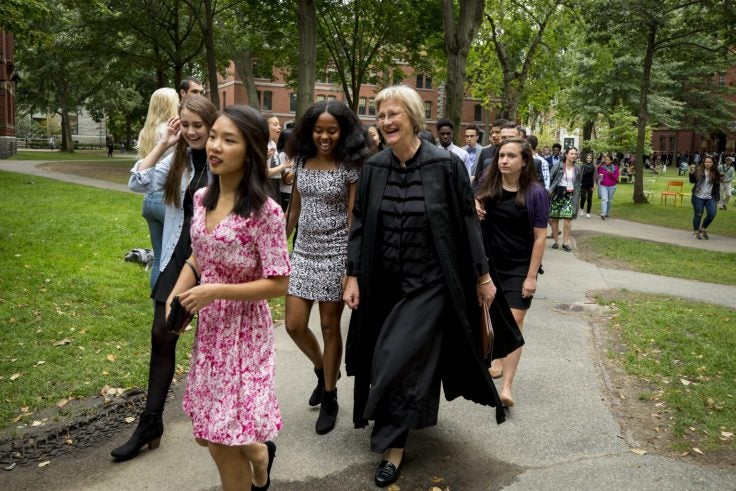 Drew Faust with some first year students