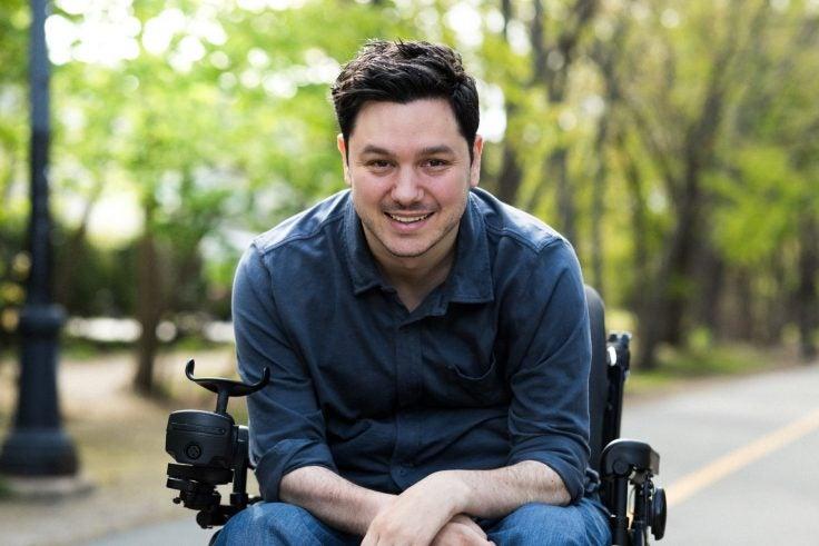 A man using a wheelchair outside