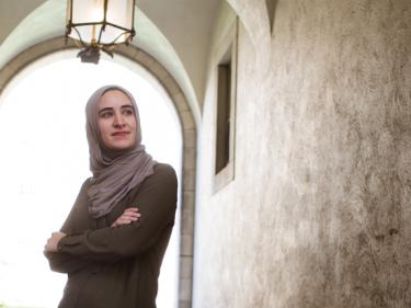 Asmaa Rimawi in a hallway