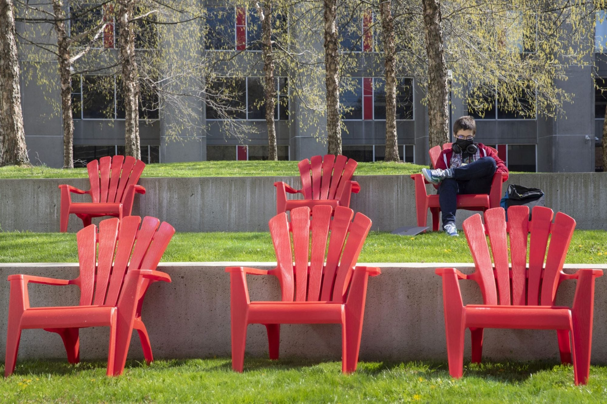 A person reading in a chair