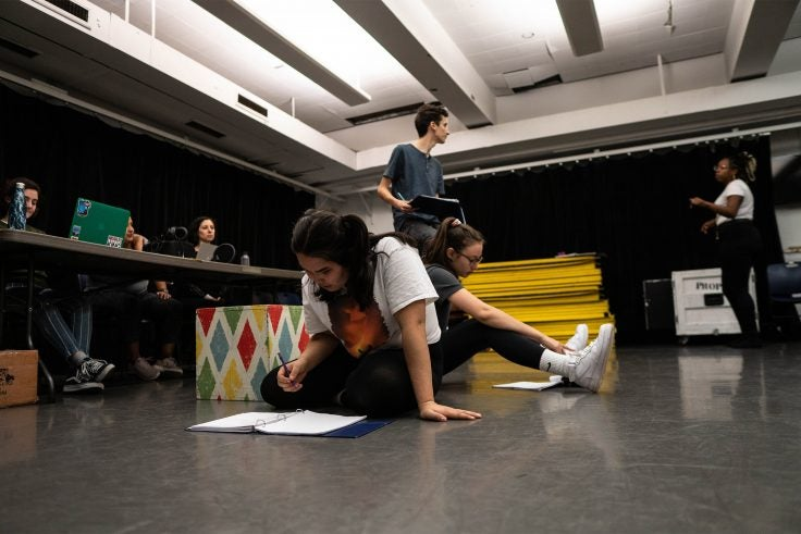 Students rehearse a play