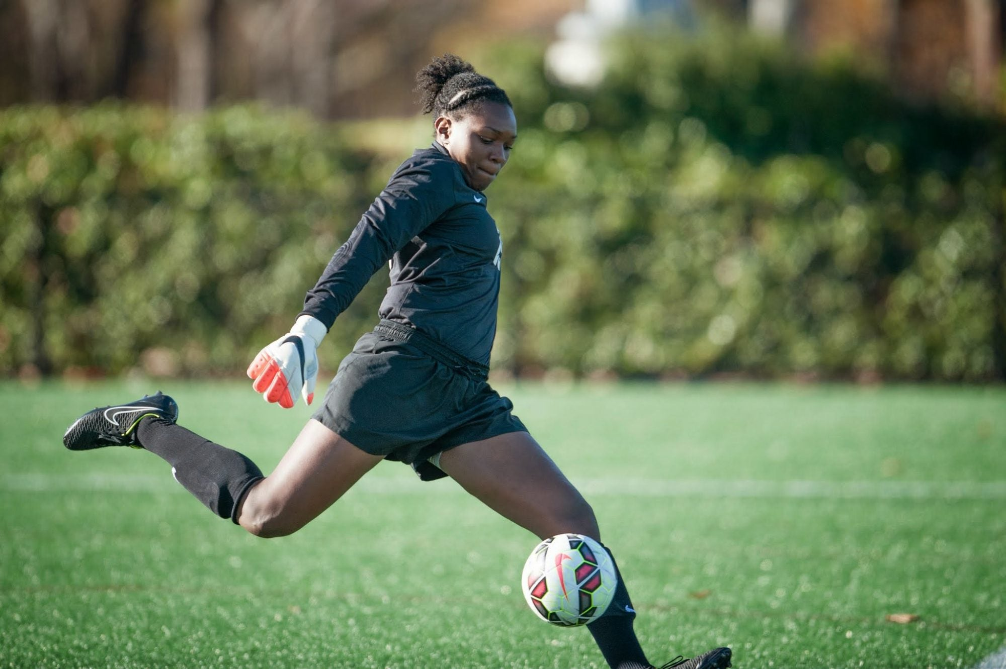 A Harvard student playing soccer