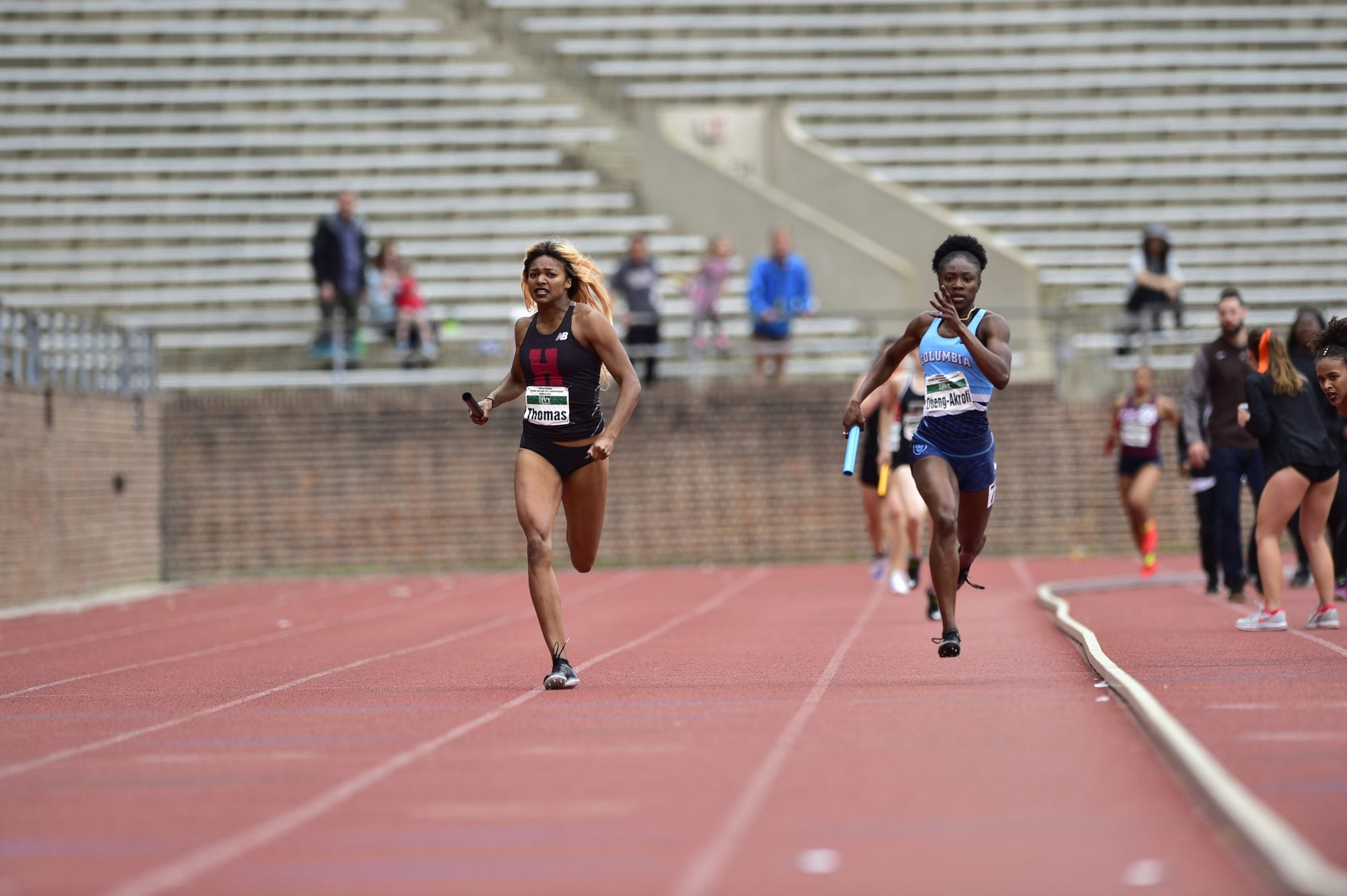 Harvard students running on a track