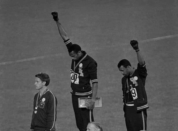 Two men showing the Black power fist on the olympic podiums