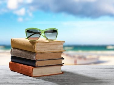 sunglasses on top of a stack of books