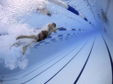 A person swimming in a pool