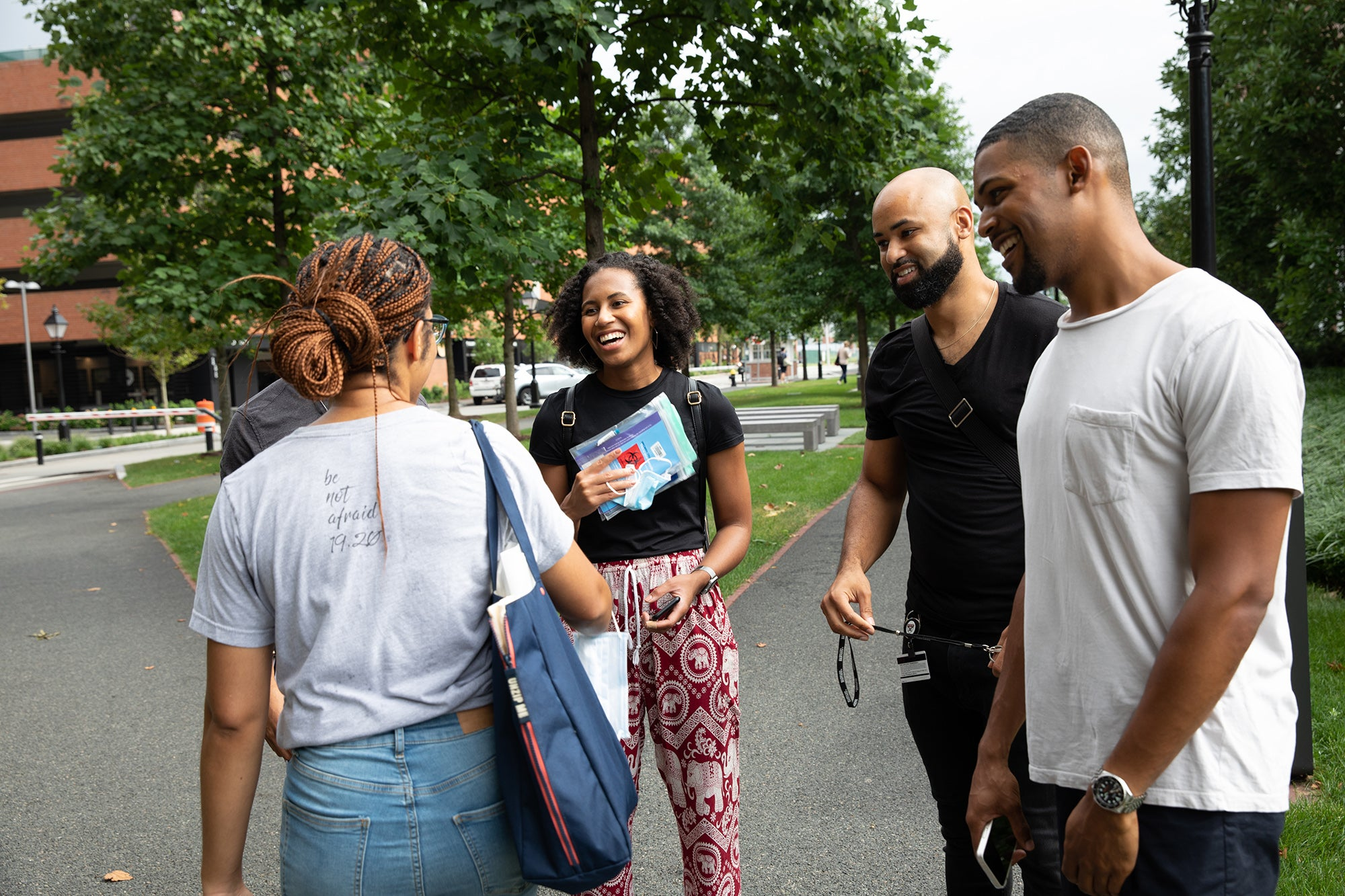 A group of students talk on campus