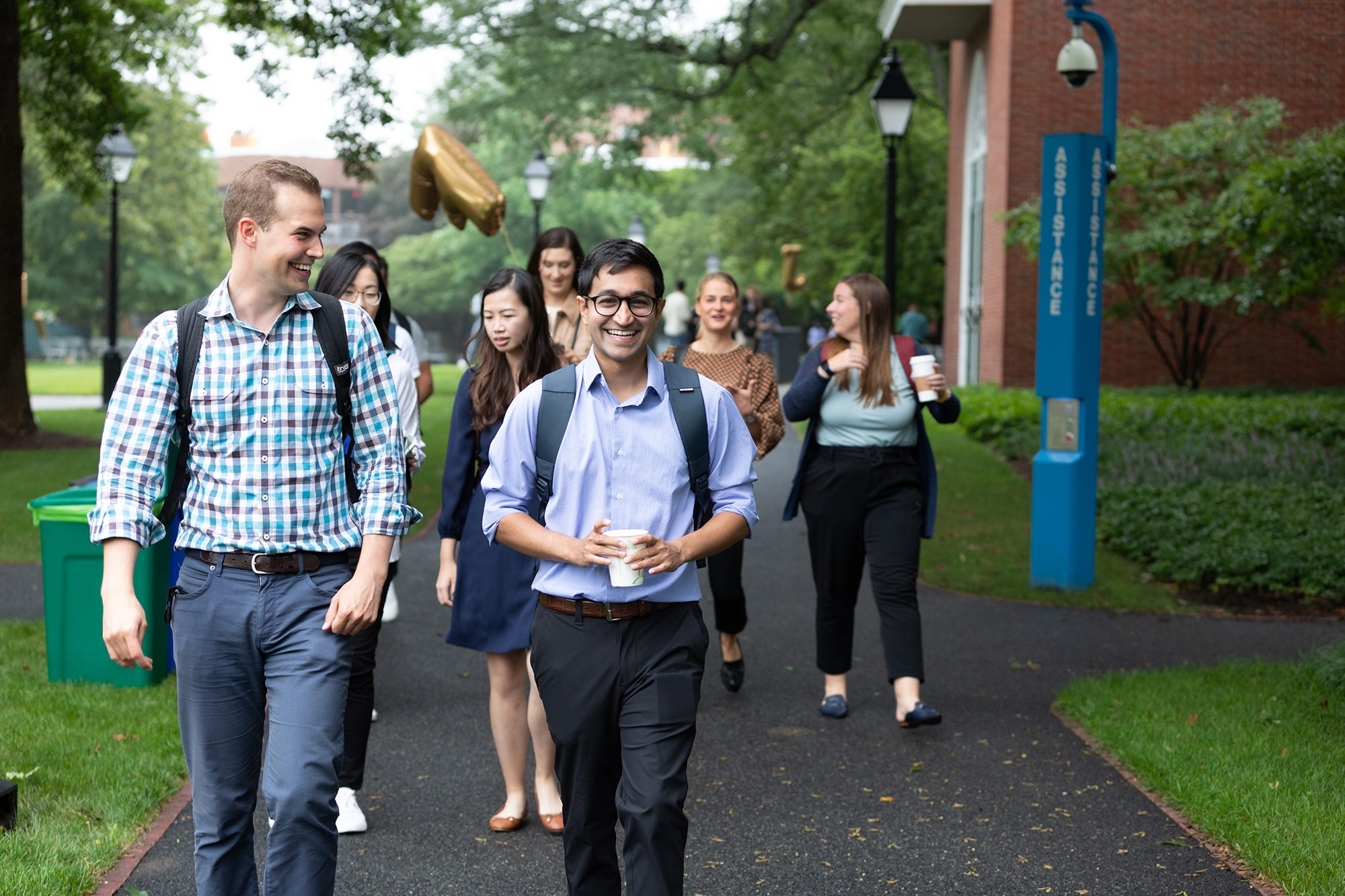 A group of students walk together on campus