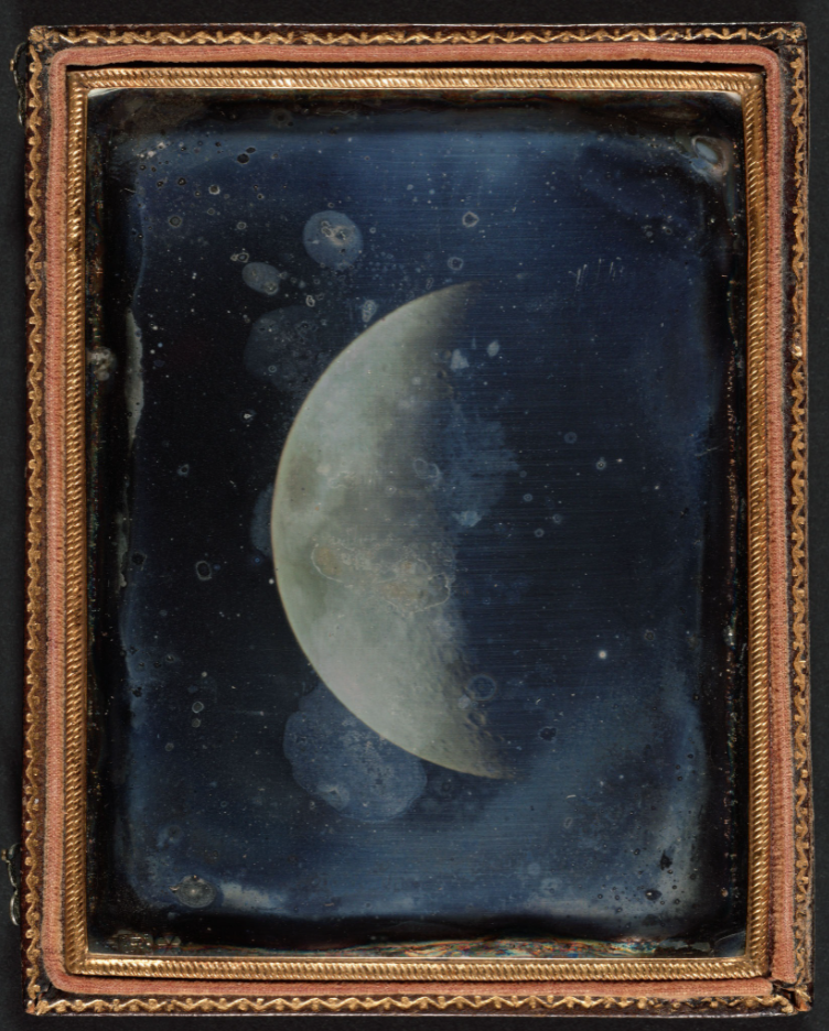 framed image of the moon against a black sky.