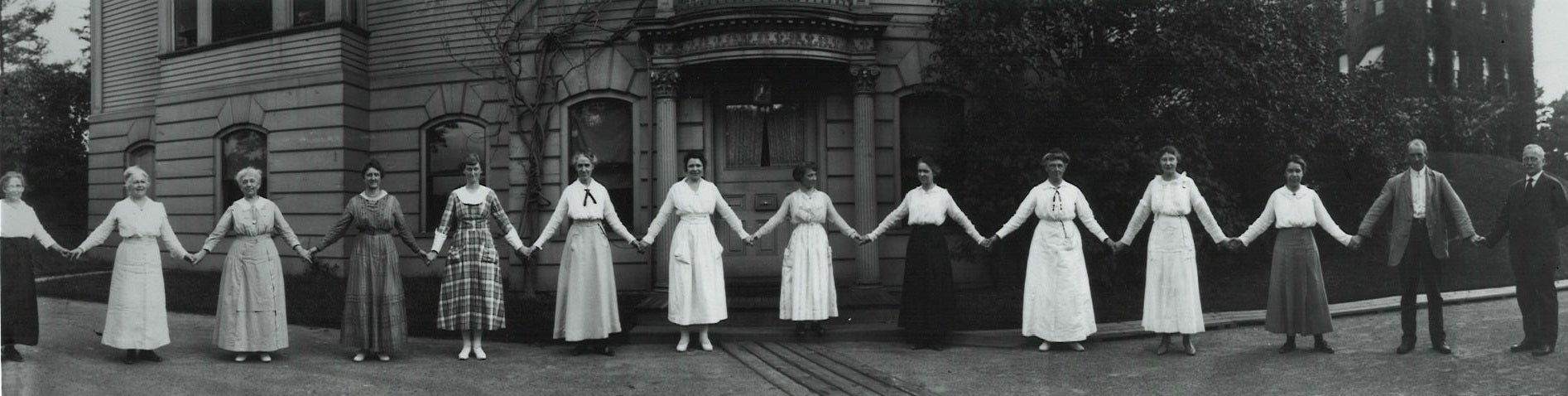 women holding hands in front of the obsevatory.
